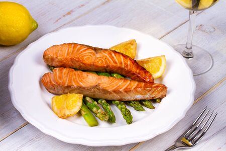 broiled: Broiled Salmon with Asparagus and Lemon Stock Photo