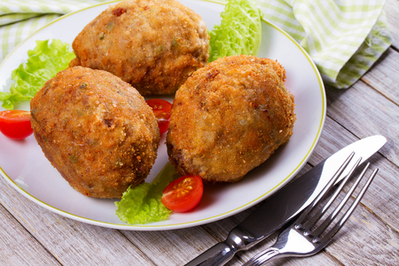 cooked pepper ball: Scotch Eggs Served with Tomato Cherry and Salad on White Plate Stock Photo