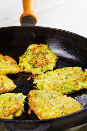 sour cream: Zucchini Pancakes With  Sour Cream in Pan