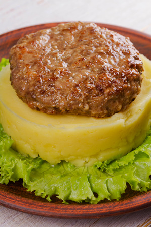 patty: Beef and pork patty with smashed potato and lettuce