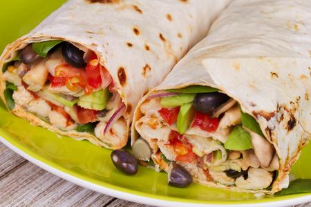 pollo rostizado: Chicken, Avocado, and Black Beans Burrito in Green Plate