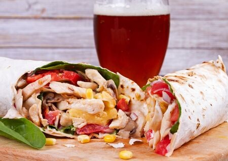 rotisserie chicken: Chicken, Mushroom, Cheese and Spinach Burritos. Glass of Beer