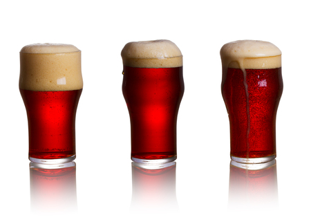 real ale: Glass of dark beer isolated on white background