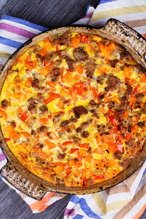 shephard: Butternut squash and sausage frittata. Pumpkin, meat, red pepper and egg casserole. View From Above, Top Studio Shot Stock Photo