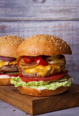 Beef burgers with red, yellow peppers, napa cabbage and cheddar