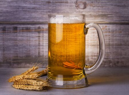 real ale: Glass of beer and barley cereal grain. Beer still life