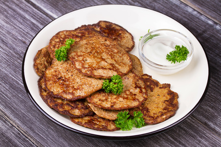 Liver Patties with Sour Cream and Parsley. Liver Cakes or Fritters of Liver. Healthy snack or take-away lunch bites.