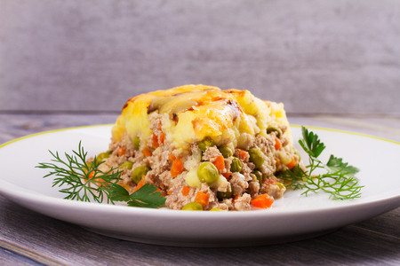 shephard: Meat, potato, cheese, carrot, onion and green peas casserole. Traditional shepherd pie