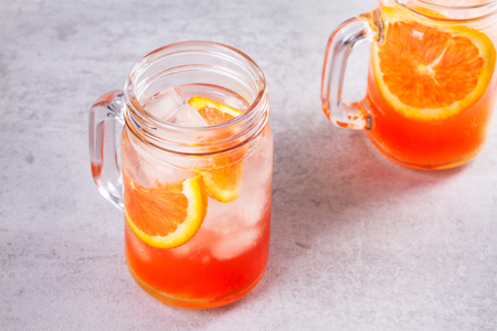 Campari and vermouth cocktail with oranges, garnished with thyme Stock Photo