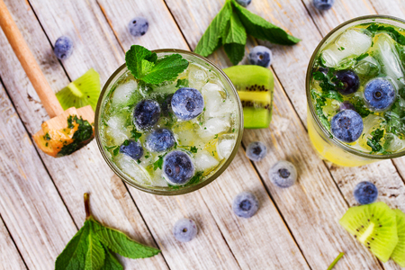 Blueberry and Kiwi Mojito. View from above, top studio shot Stock Photo