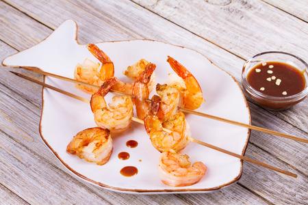 Skewered shrimp. Grilled prawns. Seafood kebabs