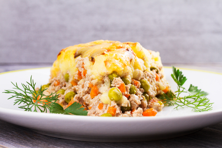 shephard: Traditional shepherd pie. Meat, potato, cheese, carrot, onion and green peas casserole