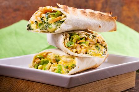 Chicken, avocado, cilantro and cheese burritos