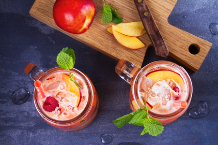 Raspberry Peach Lemonade. Fruit and berry cocktail. View from above, top studio shot