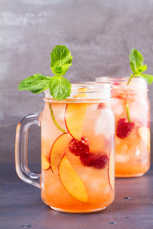 Raspberry Peach Lemonade. Fruit and berry cocktail