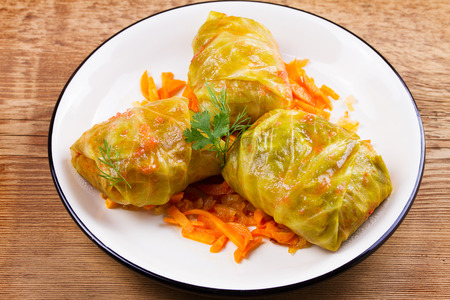 Cabbage rolls with meat; rice and vegetables. Stuffed cabbage leaves with meat. Dolma; sarma; sarmale; golubtsy or golabki - traditional and popular dish in many countries. Banco de Imagens - 83689542