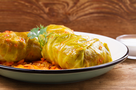 Cabbage rolls with meat; rice and vegetables. Stuffed cabbage leaves with meat. Dolma; sarma; sarmale; golubtsy or golabki - traditional and popular dish in many countries. Stock Photo