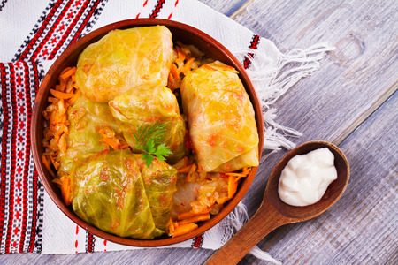 Cabbage rolls with meat, rice and vegetables. Stuffed cabbage leaves with meat. Dolma, sarma, sarmale, golubtsy or golabki - traditional and popular dish in many countries. View from above, top studio shot Stock Photo