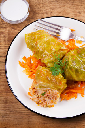 Cabbage rolls with meat; rice and vegetables. Stuffed cabbage leaves with meat. Dolma; sarma; sarmale; golubtsy or golabki. View from above, top studio shot