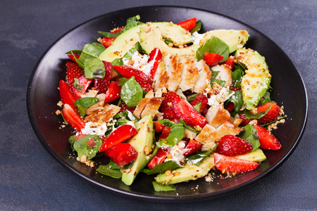 Chicken, strawberry, avocado and spinach salad with almonds