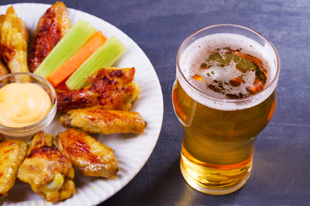 real ale: Beer and chicken wings buffalo. Ale. Beer and food concept