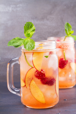 infused: Peach Raspberry Lemonade, Garnished with Mint. Fruit Berry Cocktail in Jars Stock Photo