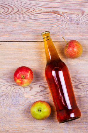 real ale: Bottles of apple and pear cider with fruits. Food and drinks concept. View from above, top studio shot. Flat lay, top view with copy space, overhead Stock Photo