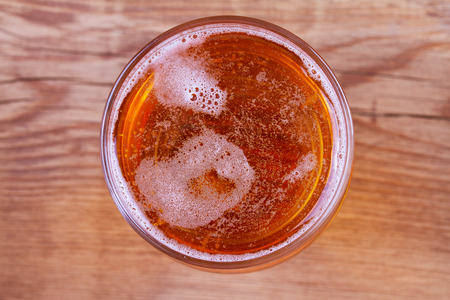 Beer on wooden background. Glass of beer or ale, view from above, top studio shot, overhead Stock Photo
