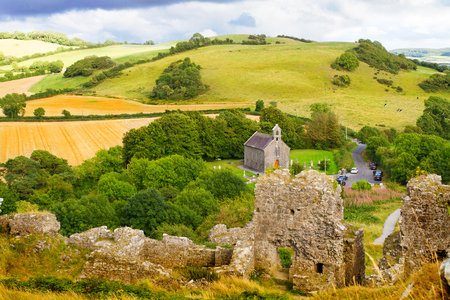 Countryside landscape with ruined castle, hills, forest, meadows and sky. Stradbally, County Laois, Ireland