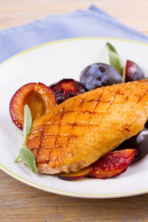 Duck breast with plums and sage Stock Photo