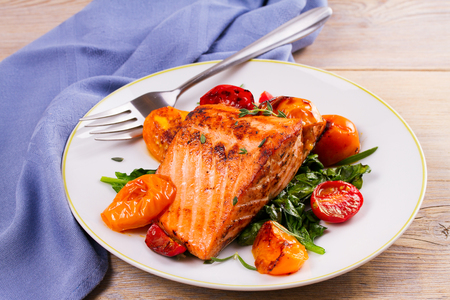 Salmon fillet with spinach, tomatoes and herbs, horizontal 写真素材