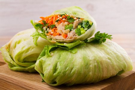 Lettuce wraps with chicken, carrot, peanuts and ginger-scallion oil, horizontal Stock Photo - 87553371