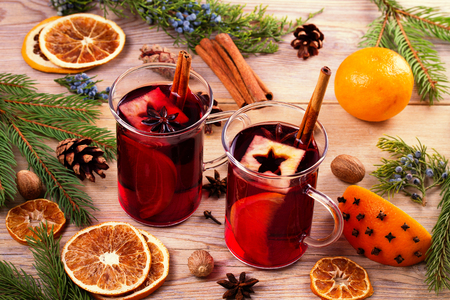 Mulled wine with spices and ingredients, horizontal