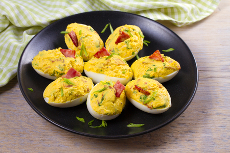 Loaded devilled eggs with bacon and chives, horizontal Reklamní fotografie