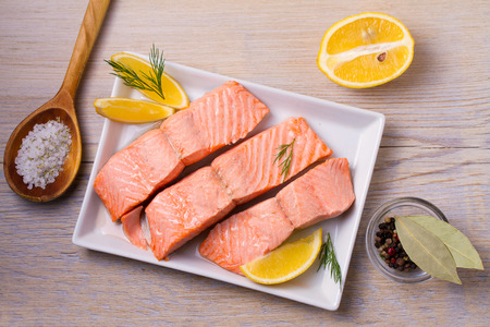 Boiled salmon on white plate. Poached salmon fillet. Good for health diet fish. View from above, top, horizontal