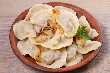 Dumplings, filled with beef meat and served with fried onion. Varenyky, vareniki, pierogi, pyrohy. Dumplings with filling Banco de Imagens - 95457417