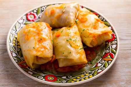 Cabbage rolls with beef, rice and vegetables. Stuffed cabbage leaves with meat. Dolma, sarma, sarmale, golubtsy or golabki. horizontal Banco de Imagens - 96273389