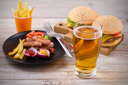 Beer and homemade burgers and fries Stock Photo