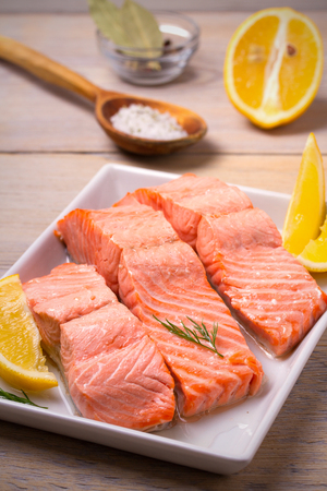 Steamed salmon fish fillet on white plate. Clean eating, healthy and diet food concept