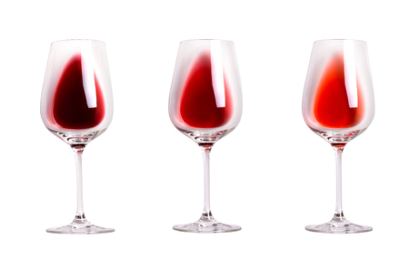 Different sorts of red wine. Array of various types of wine. Wine glasses isolated on white background