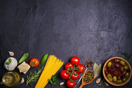 Selection of healthy food. Italian food background with spaghetti, mozzarella parmesan cheese, olives, tomatoes and rosemary. Vegetarian food banner. overhead, horizontal