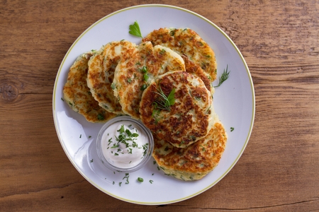 Herb and Cheese Mashed Potato Cakes. Potato Pancakes. Vegetable fritters. View from above, top studio shot Standard-Bild