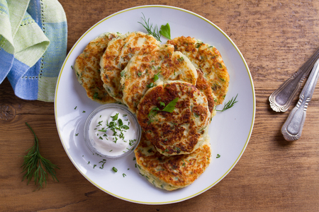 Herb and Cheese Mashed Potato Cakes. Potato Pancakes. Vegetable fritters. View from above, top studio shot Фото со стока