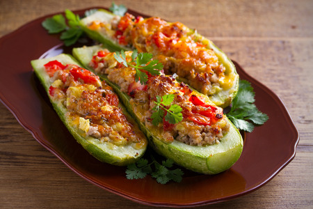 Zucchini stuffed with meat, vegetables and cheese. Zucchini boats. Loaded zucchini. horizontal