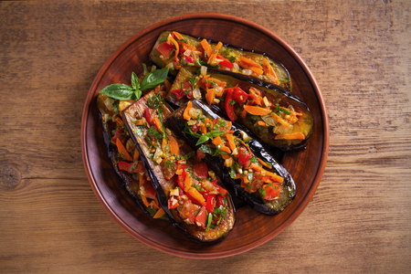 Eggplants with tomatoes, paprika, carrot, onion and garlic. Aubergine with vegetables. overhead, horizontal Reklamní fotografie