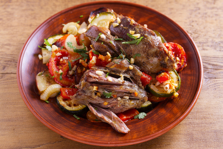 Slow cooker lamb with vegetables and garlic