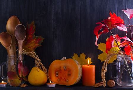 Autumn fruits, vegetables, nuts, wheat and decorations on the shelf. Harvest or Thanksgiving background. Autumn concept, copy space
