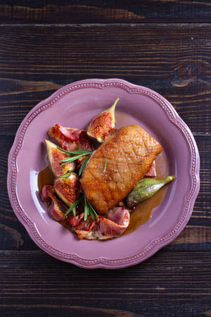 Duck breast with pancetta, rosemary and figs, baked in honey sauce. vertical Stok Fotoğraf