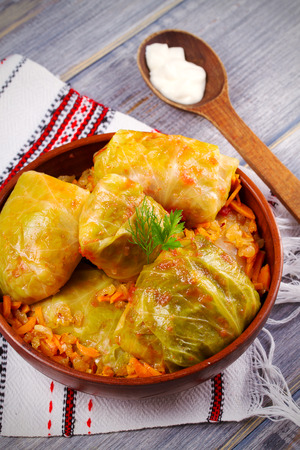 Stuffed cabbage leaves with meat, rice and vegetables. Chou farci, dolma, sarma, sarmale, golubtsy or golabki - popular dish in many countries. vertical