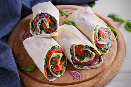 Smoked Salmon, Cream Cheese, Spinach and Arugula Wraps. Fish Burritos. horizontal Stock Photo